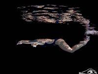 lỗi gập chân trong bơi bướm